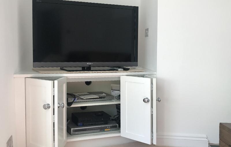 Bespoke bi-folding TV cabinet storage unit
